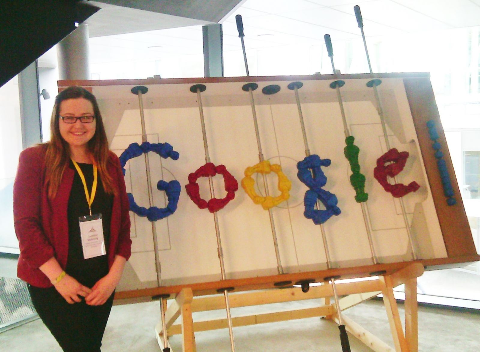 Caroline at the Google offices with a foosball table in Google logo