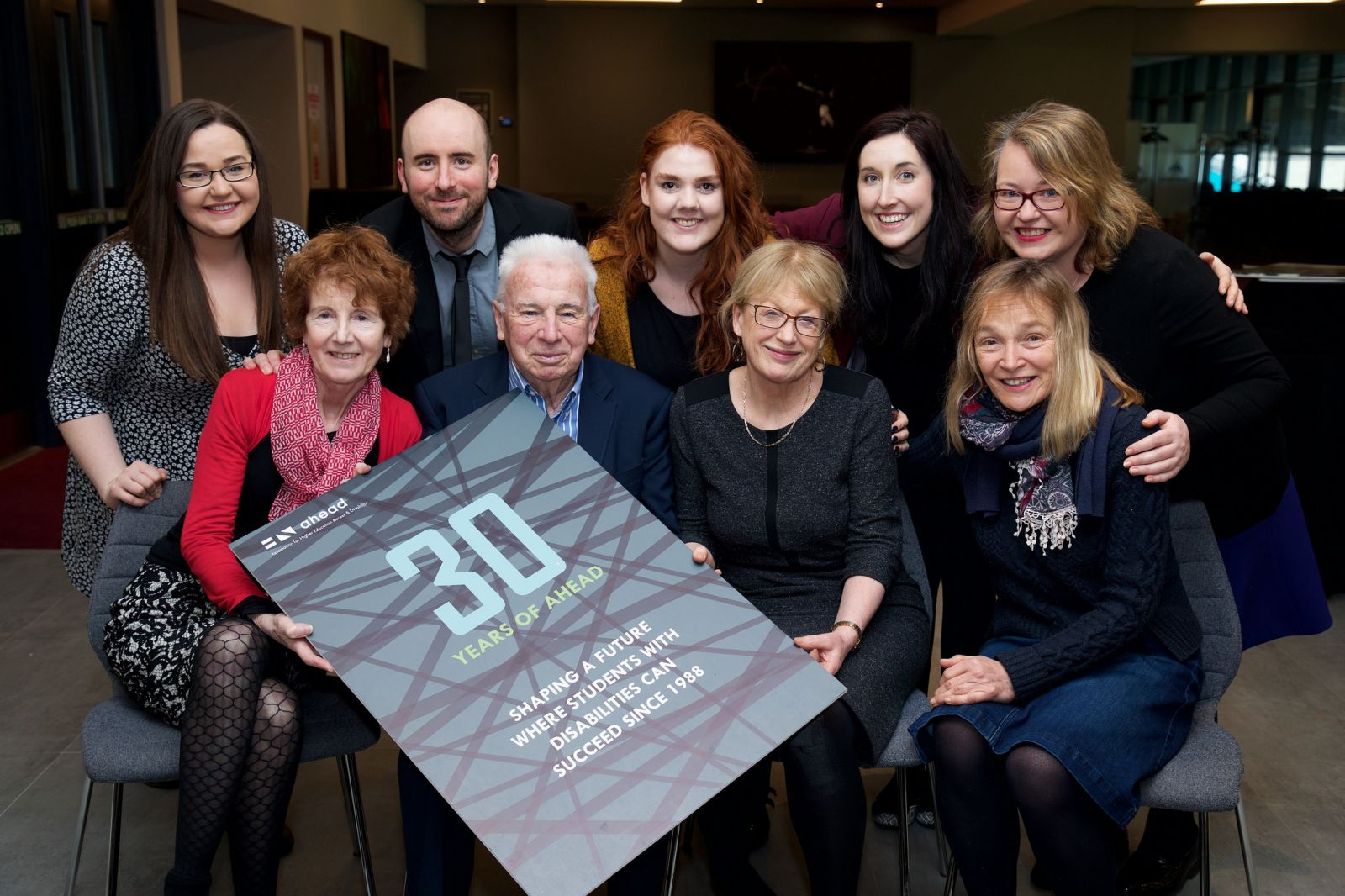 Prof. John Kelly celebrates AHEAD's 30th birthday with AHEAD Director Ann Heelan and the rest of the AHEAD team